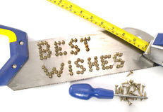 Best wishes Written in Nails on a Saw Stock Images
