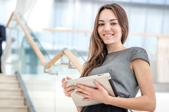 Best worker! Woman businessman stands on the stairs looking at t stock image