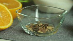 Bestandteile und Gewürze für Schokoladencreme mit orange Gelee stock video footage