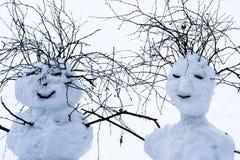 Beste Kerstmiswensen van mijnheer en mississneeuwbal Stock Foto's