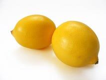Beste Schnittzitronenbilder für Fruchtsaftverpackung bedeckt Reihe mit einer Kappe Lizenzfreie Stockfotografie