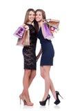 Beste vrienden die afte winkelen Stock Foto