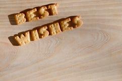 Beste wensen Hoop van eetbare brieven Stock Foto's