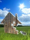 Bestehende Puzzlespiele des Hauses auf der Wiese Stockfotografie
