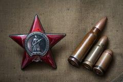 Bestellung des roten Sternes und der scharfen Munition Stockbild