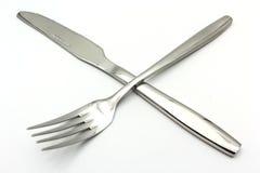 Bestickuppsättning med gaffeln och sked som isoleras på vit bakgrund Royaltyfri Fotografi