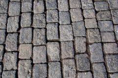 Bestrating van graniet wordt gemaakt dat Stock Foto's