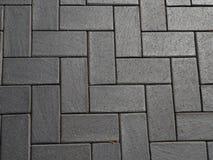 Bestratingsoppervlakte, de textuur van de steenbestrating, achtergrond stock foto's