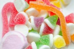 Bestruken godis för socker   arkivbild