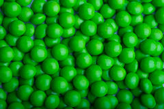 Bestruken grön godis Arkivfoton