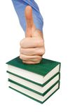 Bestseller. The human hand over the pile of books Stock Image