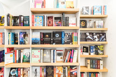 Bestseller Books For Sale On Library Shelf. BUCHAREST, ROMANIA - MARCH 16, 2015: Bestseller Books For Sale On Library Shelf Royalty Free Stock Photography