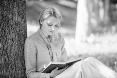 Bestseller top list. Books every girl should read. Relax leisure an hobby concept. Best self help books for women. Girl. Concentrated sit park lean tree trunk royalty free stock images
