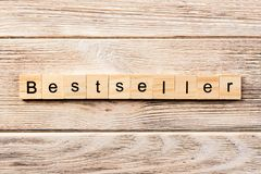 Bestseller word written on wood block. bestseller text on table, concept.  royalty free stock images