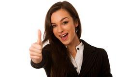Besutiful打手势与显示的女商人赞许的成功 图库摄影