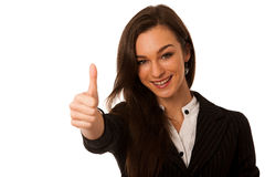 Besutiful business woman gesturing success with showing thumb up Royalty Free Stock Photos