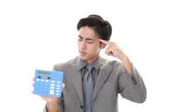 Besviken asiatisk affärsman arkivfoto