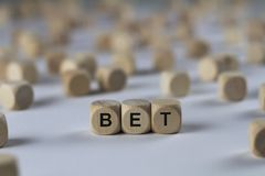 Bet - cube with letters, sign with wooden cubes. Bet - wooden cubes with the inscription `cube with letters, sign with wooden cubes`. This image belongs to the Stock Photos