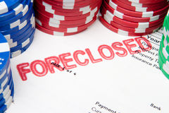 Bet the House Poker Chips on Foreclosed Mortgage. Mortgage document with foreclosed stamped on it, surrounded by poker chips.  Suggesting the current US mortgage Stock Photo
