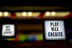 Buttons on front of gambling slot machine. Bet one creditcand play max credits  buttons on gambling slot machine Stock Photos