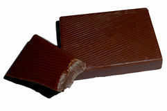 Bet stycken av choklad som isoleras på vit Royaltyfria Bilder