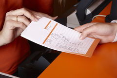 Bet ticket with male and female hands Stock Photography
