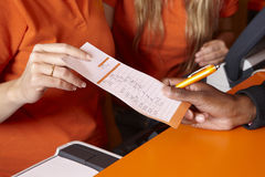 Bet tickets detail with hands and pen Stock Photo
