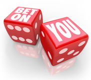 Bet On You Two Dice Self Confidence Follow Your Dreams. Bet On You words on two red dice to illustrate self confidence and following your dreams in career or Royalty Free Stock Photos