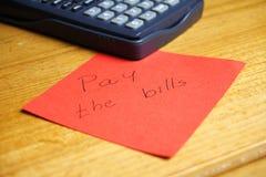 Betaal de rekeningen Stock Afbeelding