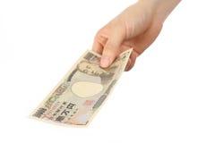 Betaal een Japanse 10000YEN-rekening Royalty-vrije Stock Afbeeldingen