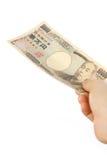 Betala en räkning för japan 10000YEN Arkivfoton