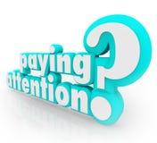 Betala uppmärksamhetfrågan som förstår viktig information Arkivbild