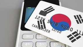 Betaling of POS terminal met creditcard die vlag van Zuid-Korea kenmerken Koreaans kleinhandelshandel of bankwezensysteem Royalty-vrije Stock Afbeeldingen