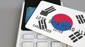 Betalning eller pos.-terminal med kreditkorten som presenterar flaggan av Sydkorea Kommers eller banksystem för korean återförsäl Royaltyfria Bilder