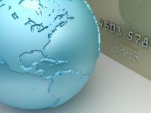 Betalningbegrepp Kreditkort med en världskarta Arkivbild