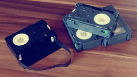 Betamax Tapes on Top of Brown Wooden Surface Royalty Free Stock Photography