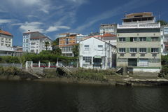 Betanzos with Mandeo. Some buildings of Betanzos with the river of Mandeo (by low tide) in the front Royalty Free Stock Photo