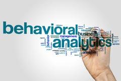 Beteende- begrepp för analyticsordmoln på grå bakgrund arkivfoto