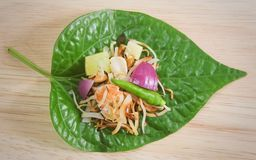 Betel Leaf Wrapped Bite Size of Thai Appetizer. Thai Traditional Snack and Dessert, Dish of Miang Kum or Sweet and Spicy Betel Leaf Wrap Filled with Coconut Stock Photography
