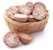 Betel nut. S in a basket over white background Stock Photos