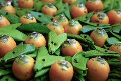 Betel nuts. An orange betel nuts with leafs Stock Photography