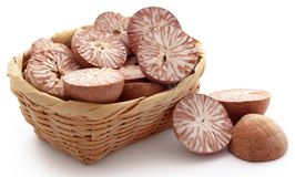Betel nuts. In a basket over white background Stock Photo