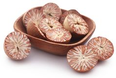 Betel nuts. In a bowl over white background Stock Photos