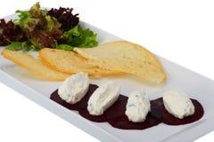 Beterrabas com queijo Imagens de Stock