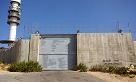 Closed Beth Jallah crossing. Israeli oppression of Palestine,  fence with graffiti Stop The Occupation Stock Photography