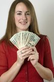 Bethany 17680. Mid 20's brunette female hold $500 in twenties in studio portrait royalty free stock photography