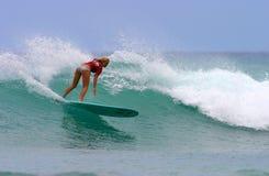 Bethany Hamilton Surfing in Hawaii. Pro Surfer, Bethany Hamilton, surfing in Waikiki on the island of Oahu, Hawaii.  Bethany Hamilton lost her arm during a shark Royalty Free Stock Photography