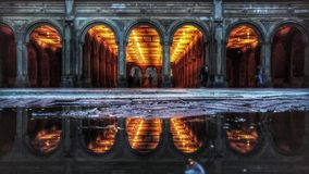 Bethesda Terrace in Central Park. Bethesda Terrace and Fountain overlook The Lake in New York City's Central Park. The fountain is located in the center of the Royalty Free Stock Image