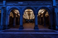 The Bethesda Terrace Underpass in Central Park. Viewed here would be the Bethesda Terrace Underpass with its lit up interior and the blue hour tones of the early Royalty Free Stock Photography