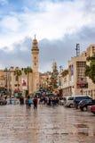 BETHLEHEM, ISRAEL - CIRCA NOVEMBER 2011: Street of Bethlehem on cloudy day. BETHLEHEM, ISRAEL - CIRCA NOVEMBER 2011: Buildings of Bethlehem city with flags and Stock Photos